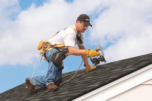 Roofer with a nail gun